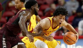 Iowa State guard Lindell Wigginton steals the ball from Maryland-Eastern Shore guard Ahmad Frost, left, during the first half of an NCAA college basketball game, Wednesday, Dec. 20, 2017, in Ames, Iowa. (AP Photo/Charlie Neibergall)