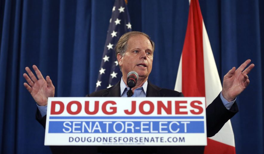 In this Wednesday, Dec. 13, 2017, photo, U.S. Sen.-elect Doug Jones speaks during a news conference in Birmingham, Ala. (AP Photo/John Bazemore, File)