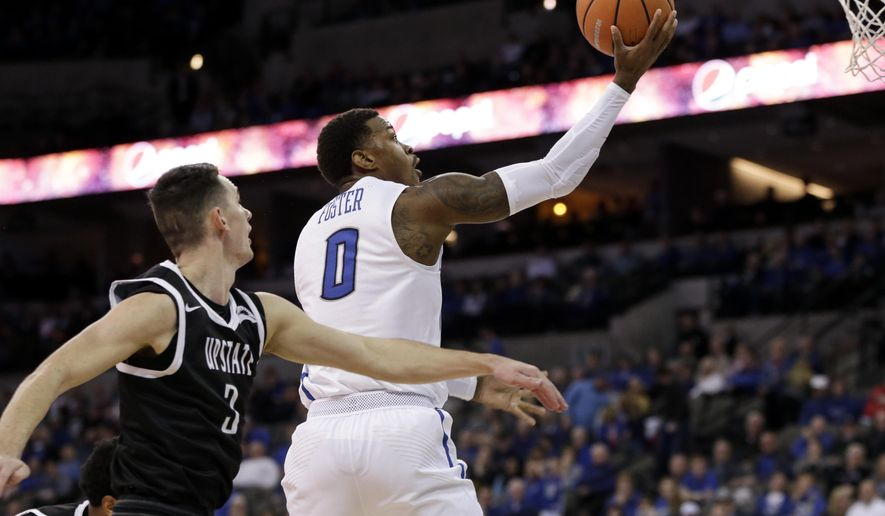 Creighton's Marcus Foster (0) goes for a layup in front of USC Upstate's Jure Span (3) during the first half of an NCAA college basketball game in Omaha, Neb., Wednesday, Dec. 20, 2017. (AP Photo/Nati Harnik)