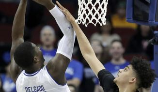 Seton Hall center Angel Delgado (31) goes up for a shot against Wagner forward Nigel Jackson (0) during the first half of an NCAA college basketball game, Wednesday, Dec. 20, 2017, in Newark, N.J. (AP Photo/Julio Cortez)