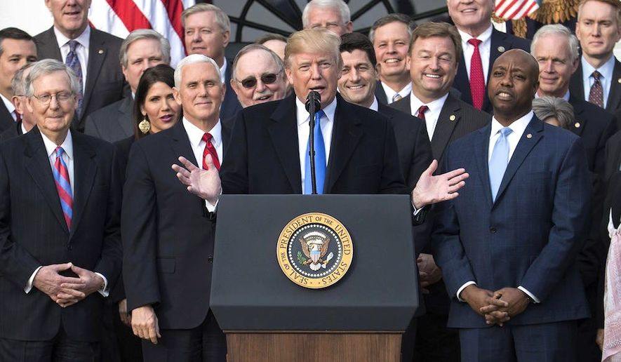 President Trump, Vice President Mike Pence ad Republican leadership from House and Senate have a jovial moment following the final passage of tax reform legislation. The GOP also enjoyed a record-breaking year for fundraising. (AP Photo/Carolyn Kaster) (Associated Press)