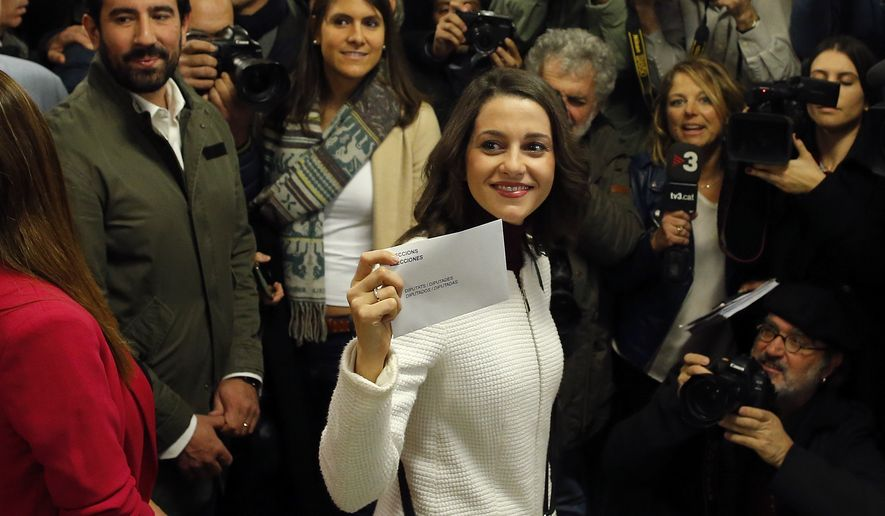 Ciutadans (Citizens) party leader Ines Arrimadas displays her ballot envelope before voting for the Catalan regional election in Barcelona, Spain, on Thursday, Dec. 21, 2017. Catalans are choosing new political leaders in a highly contested election called by central authorities to quell a separatist bid in Spain's northeastern region. (AP Photo/Manu Fernandez)