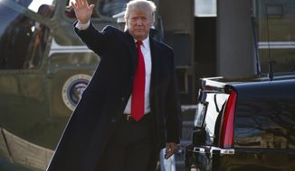 President Donald Trump steps off Marine One after landing at Walter Reed National Military Medical Center, Thursday, Dec. 21, 2017, in Bethesda, Md. (AP Photo/Evan Vucci)