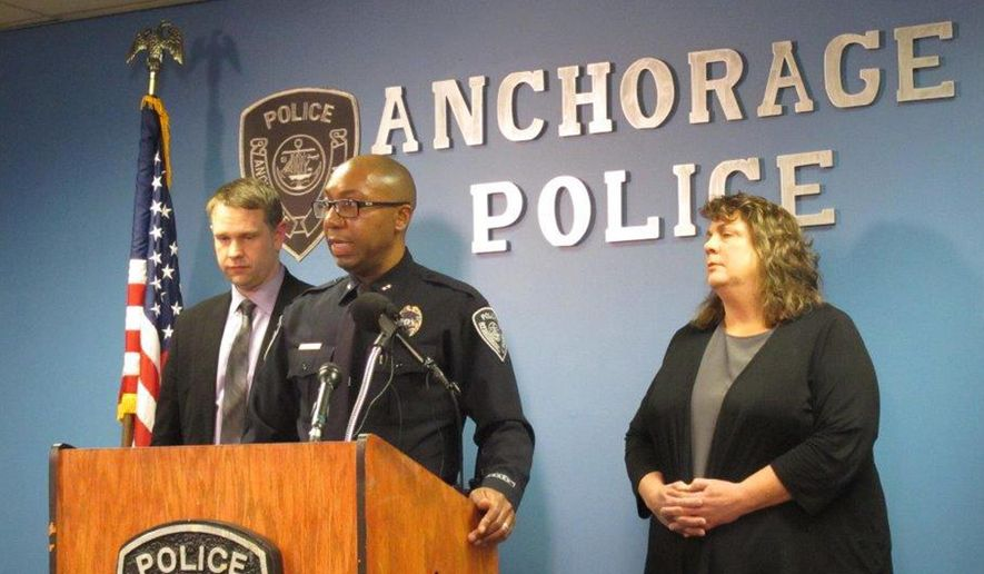 Deputy Anchorage Police Chief Kenneth McCoy, middle, flanked by Lt. Josh Nolder, left, and Capt. Julie Shank, speaks to reporters at a news conference Thursday, Dec. 21, 2017, in Anchorage, Alaska. McCoy released details of an officer-involved fatal shooting of a suspect from late Wednesday, Dec. 20, 2017. (AP photo/Rachel D'Oro)