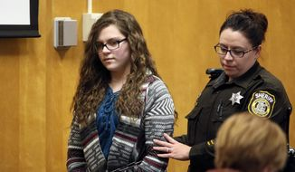 Anissa Weier, one of two Wisconsin girls who tried to kill a classmate to win favor with a fictional horror character named Slender Man, is led into the Waukesha County Court for her sentencing hearing, Thursday, Dec. 21, 2017, in Waukesha, Wis. She was sentenced to 25 years in a mental hospital, the maximum punishment possible. (Michael Sears/Milwaukee Journal-Sentinel via AP)
