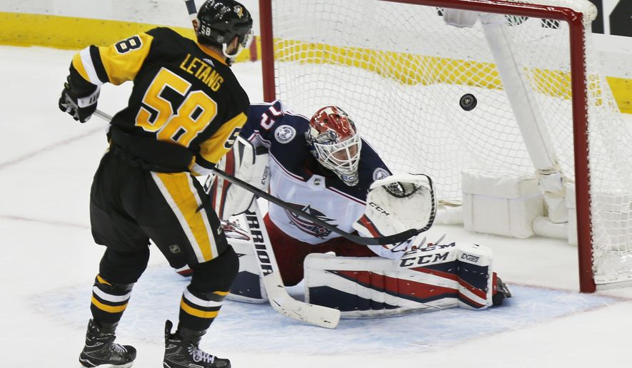 Pittsburgh Penguins' Kris Letang scores over Columbus Blue Jackets goalie Sergei Bobrovsky during the shootout in an NHL hockey game Thursday, Dec. 21, 2017, in Pittsburgh. The Penguins won 3-2. (AP Photo/Keith Srakocic)