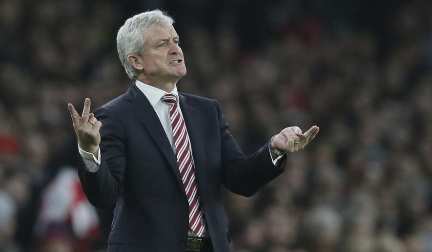 Stoke City manager Mark Hughes gestures during the English Premier League soccer match between Arsenal and Stoke City at the Emirates stadium in London, Saturday Dec. 10, 2016. It seems hard for the Stoke manager Mark Hughes to escape the rebellion chants from fans. (AP Photo/Tim Ireland)