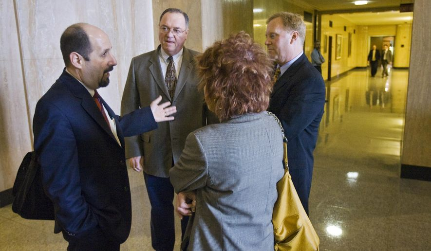 In this undated photo, Bruce Goldberg, head of Oregon's Department of Human Services, talks with Jeff Heatherington, second from left, Cindy Becker, back to camera, and Bill Murray in the hall in front of the Governor's office at the Capitol in Salem, Ore. (Doug Beghtel/The Oregonian via AP)