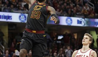 Cleveland Cavaliers' LeBron James (23) drives to the basket past Chicago Bulls' Lauri Markkanen (24), from Finland, durign the first half of an NBA basketball game Thursday, Dec. 21, 2017, in Cleveland. (AP Photo/Tony Dejak)