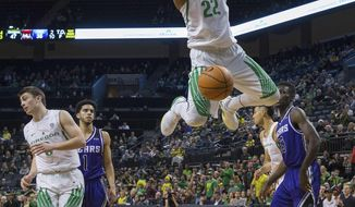 Oregon's MiKyle McIntosh dunks against Central Arkansas during the first half of an NCAA college basketball game in Eugene, Ore., Wednesday, Dec. 20, 2017. (Brian Davies/The Register-Guard via AP)