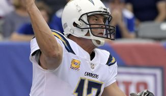 FILE - In this Oct. 8, 2017, file photo, Los Angeles Chargers quarterback Philip Rivers (17) throws a pass during the first half of an NFL football game against the New York Giants, in East Rutherford, N.J. The Chargers (7-7) are still in the middle of the AFC playoff mix, but their margin for error has disappeared. They play the Jets on Sunday. (AP Photo/Bill Kostroun, File)