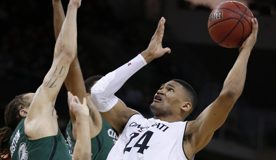Cincinnati forward Kyle Washington (24) shoots against Cleveland State forward Jamarcus Hairston, left, during the first half of an NCAA college basketball game Thursday, Dec. 21, 2017, in Highland Heights, Ky. (AP Photo/Gary Landers)