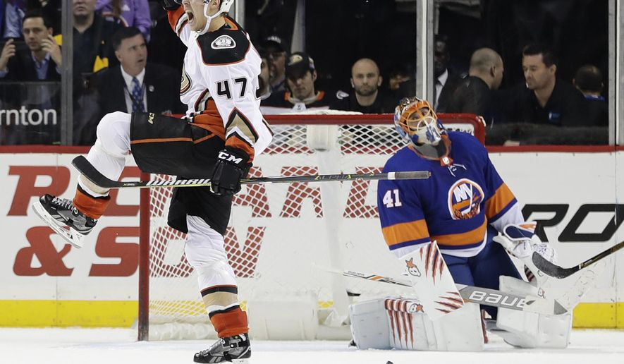 Anaheim Ducks' Hampus Lindholm (47) celebrates after scoring the game winning goal as New York Islanders goalie Jaroslav Halak (41) reacts during the overtime period of an NHL hockey game Thursday, Dec. 21, 2017, in New York. The Ducks won 5-4. (AP Photo/Frank Franklin II)
