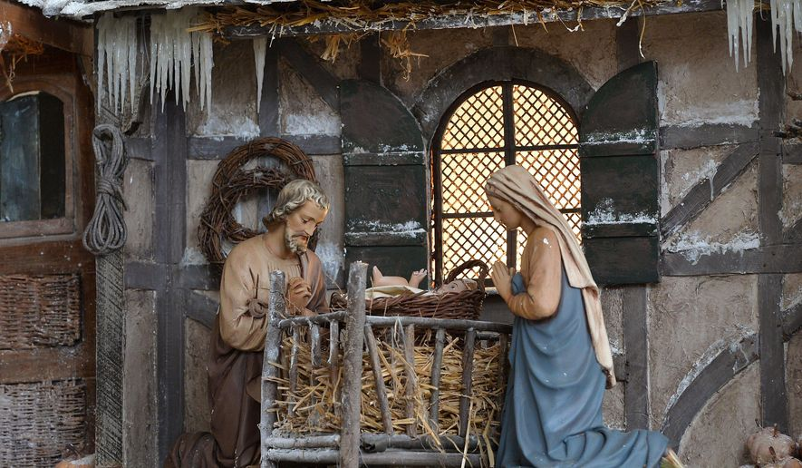 In this Wednesday, Dec. 7, 2017 photo, a nativity scene on display at the First Presbyterian Church of the Covenant was created in 2014 by Michael DeSanctis, a fine arts, pastoral studies and theology professor at Gannon University, in Erie, Pa. Several of DeSanctis' past nativity scenes are on display in a small gallery inside First Presbyterian Church of the Covenant and include posters that describe how he built them. (Christopher Millette/Erie Times-News via AP)