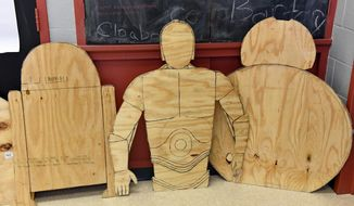 Star War plywood figures that students cut are on display at Tabernacle Elementary School on Wednesday, Dec. 13, 2017 in Tabernacle, N.J.  Students at the school are building carts that will hold school supplies which will be Star Wars themed.   (Carl Kosola/Burlington County Times via AP)