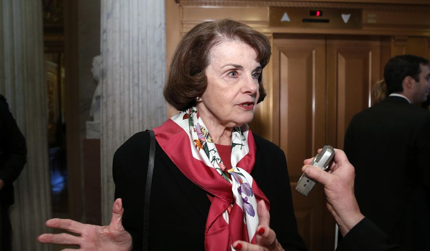 In this Dec. 19, 2017, file photo, Sen. Dianne Feinstein, D-Calif., speaks with a reporter on Capitol Hill in Washington. (AP Photo/Alex Brandon, file)