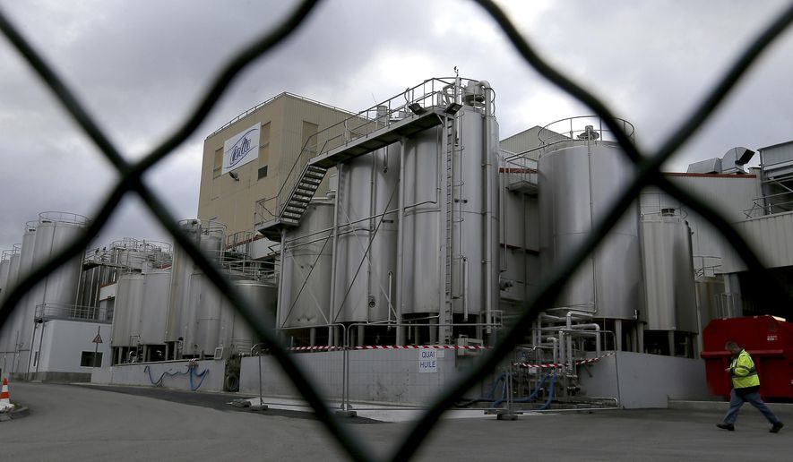 FILE - This Monday Dec. 11, 2017 file picture shows a general view of the Lactalis plant and milk production site where possible source of the outbreak has been identified in Craon, western France. A tainted baby milk scandal affecting some 30 countries is growing, as French dairy giant Lactalis recalled millions more products globally because of salmonella contamination. (AP Photo/David Vincent, File)