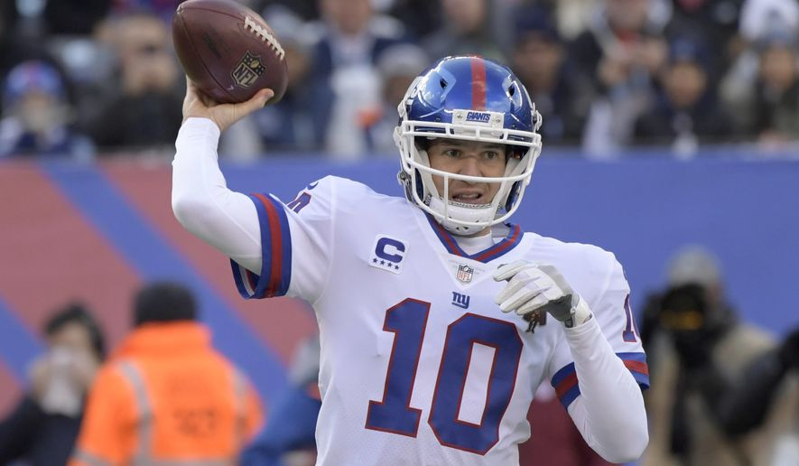 FILE - In this Sunday, Dec. 10, 2017 file photo, New York Giants quarterback Eli Manning (10) throws a pass during the first quarter of an NFL football game against the Dallas Cowboys in East Rutherford, N.J. In his turbulent 14th NFL season, Eli Manning returns to the scene of one of his greatest triumphs. Manning will lead the limping New York Giants (2-12) into University of Phoenix Stadium to face Arizona (6-8) on Sunday, Dec. 24, 2017. (AP Photo/Bill Kostroun, File)