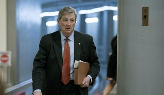 In this Dec. 19, 2017, photo, Sen. John Kennedy, R-La., arrives on Capitol Hill in Washington. (AP Photo/Andrew Harnik) ** FILE **