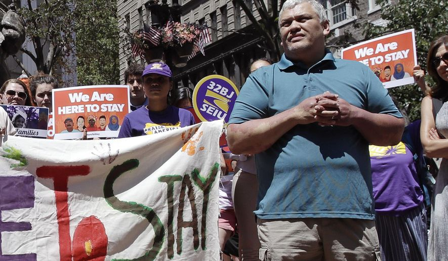"File- In this July 6, 2017 file photo, MIT janitor Francisco Rodriguez listens to speakers during a ""Here to Stay"" rally at the Irish Famine Memorial in Boston. Rodriguez, who was facing deportation to El Salvador, has been released from a Boston jail. Francisco Rodriguez-Guardado was released by U.S. Immigration and Customs Enforcement on Thursday. Dec. 21, 2017, after being held since July at the Suffolk County House of Corrections. His lawyers say his removal proceedings have been stayed pending their request to reopen his asylum case. Rodriguez-Guardado's mother says the family is ""overjoyed."" (AP Photo/Charles Krupa)"