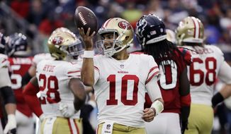 FILE - In this Dec. 10, 2017, file photo, San Francisco 49ers quarterback Jimmy Garoppolo (10) smiles after a play during the second half of an NFL football game against the Houston Texans, in Houston. The player who brought hope to the 49ers after three-plus years of struggles in San Francisco will be in for his toughest test yet this week. Garoppolo and the 49ers (4-10) host the playoff-bound Jacksonville Jaguars (10-4) on Sunday and their punishing defense that leads the NFL in fewest points allowed, most sacks and lowest yards per play against. (AP Photo/David J. Phillip, File)
