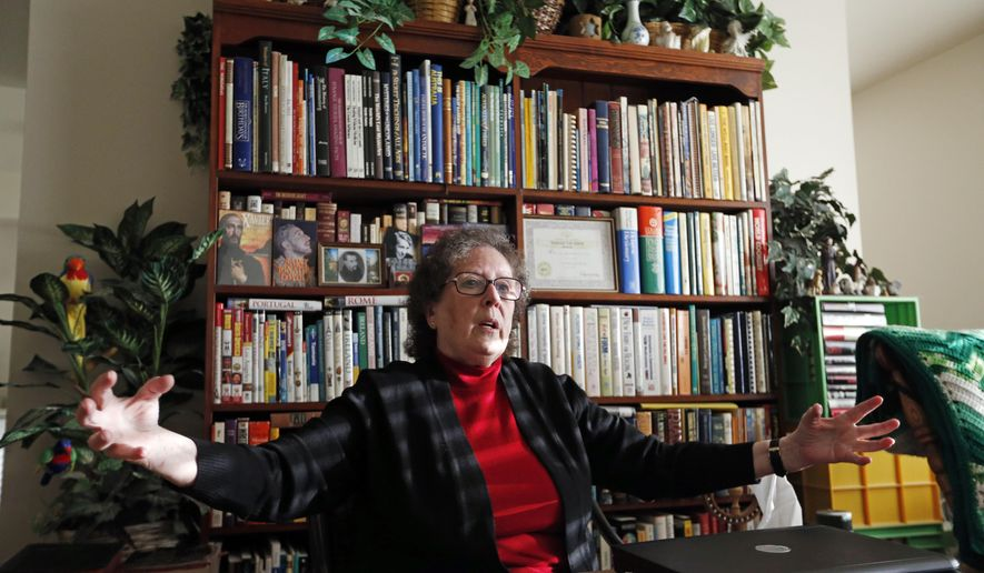 In this Monday, Nov. 6, 2017, photo, show Helen Radkey at her home in Holladay, Utah. Mormons are posthumously baptizing Holocaust victims as well as grandparents of public figures like Donald Trump, Hillary Clinton and Steven Spielberg, despite church rules intended to restrict the ceremonies to a member's ancestors, according to a researcher Helen Radkey who has spent two decades monitoring the church's massive genealogical database (AP Photo/Rick Bowmer)