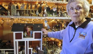In this Wednesday, Dec. 20, 2017 photo Shirley Squires, of Guilford, Vt., speaks with a reporter about her collection of more than 1,400 nativity scenes on display in her home. Each Christmas, she gets help putting up the miniature scenes and then opens her home to school groups and others for viewing. (AP Photo/Lisa Rathke)