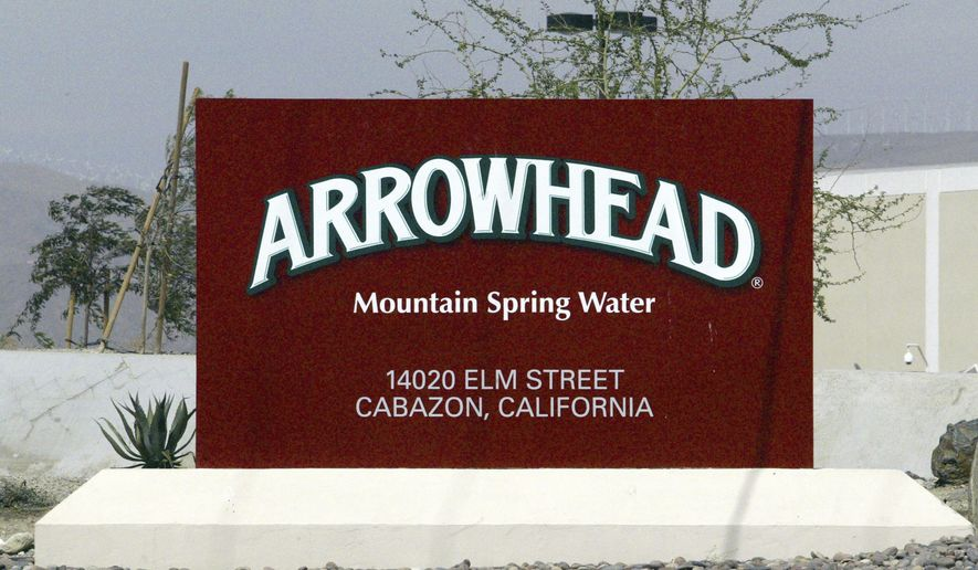 FILE - In this July, 7, 2004, file photo, a sign at the entrance to the Arrowhead Mountain Spring Water Company bottling plant, owned by Swiss conglomerate Nestle, on the Morongo Indian Reservation near Cabazon, Calif. Nestle, which sells Arrowhead bottled water, may have to stop taking millions of gallons of water from Southern California's San Bernardino National Forest because state regulators concluded it lacks valid permits. The State Water Resources Control Board notified the company on Wednesday, Dec. 20, 2017, that an investigation concluded it doesn't have proper rights to pipe about three-quarters of the water it currently withdraws for bottling. (AP Photo/Damian Dovarganes, File)