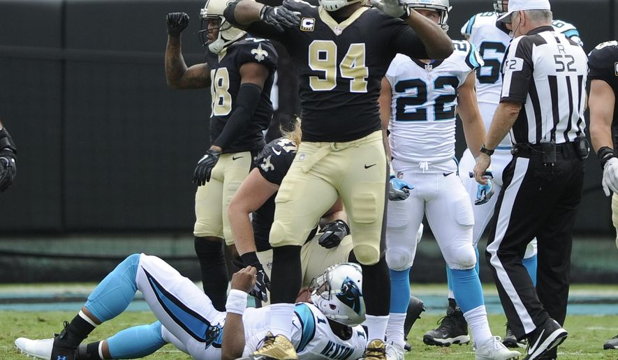 FILE - In this Sunday, Sept. 24, 2017 file photo, New Orleans Saints' Cameron Jordan (94) celebrates after sacking Carolina Panthers' Cam Newton (1) in the first half of an NFL football game in Charlotte, N.C. Holiday cheer could be in order in New Orleans, Carolina, Atlanta, Los Angeles and Kansas City this weekend. (AP Photo/Mike McCarn, File)