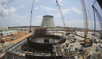 FILE- This June 13, 2014, file photo, shows construction on a new nuclear reactor at Plant Vogtle power plant in Waynesboro, Ga. In a Thursday, Dec. 21, 2-17 decision, Georgia's utility regulators are allowing construction to continue on two new nuclear reactors at Plant Vogtle despite massive cost overruns for the multi-billion-dollar project. (AP Photo/John Bazemore, File)