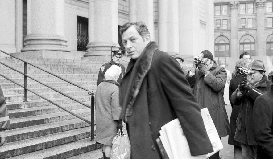 File - In this March 13, 1972 file photo, author Clifford Irving is seen as he enters federal court in New York. Irving, the prankster who wrote a phony autobiography of billionaire Howard Hughes and fooled a major publisher in 1971 has died at 87. The New York Times reports Irving's wife, Julie Irving, confirmed that he died Tuesday, Dec, 19, 2017, at a hospice near his Sarasota home. (AP Photo/Jim Wells, File)