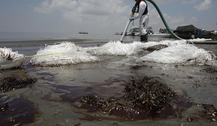 FILE - In this June 9, 2010 file photo, a worker uses a suction hose to remove oil washed ashore from the Deepwater Horizon spill, in Belle Terre, La. The Trump administration has halted an independent scientific study of offshore oil inspections by the federal safety agency created after the 2010 spill in the Gulf of Mexico. The National Academies of Sciences, Engineering and Medicine was told to cease review of the inspection program conducted by the federal Bureau of Safety and Environmental Enforcement. Established following the massive BP spill, the bureau was assigned the role of improving offshore safety inspections and federal oversight. (AP Photo/Eric Gay, File)