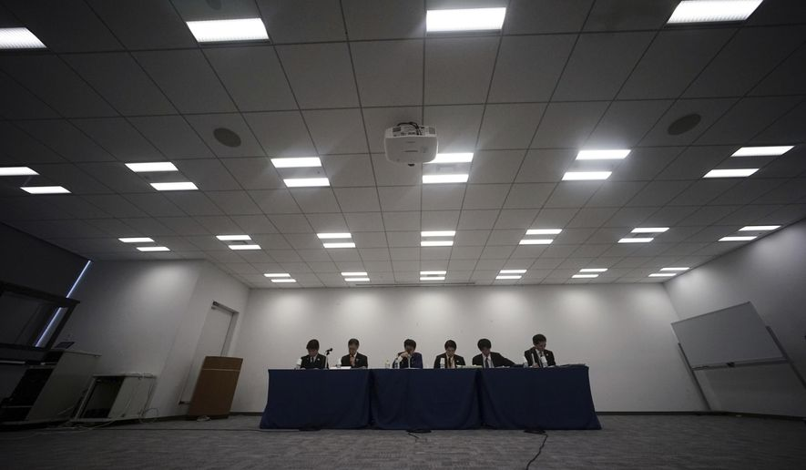 Officials from the Tokyo 2020 Games and Tokyo Municipal government attend a press conference on the updated version of the Games budget in Tokyo Friday, Dec. 22, 2017. The latest price tag for the 2020 Tokyo Olympics has been trimmed slightly, but is still nearly twice the initial estimate even after a major cost-cutting effort. The organizers said Friday that the event will cost a total 1.35 trillion yen ($11.9 billion). (AP Photo/Eugene Hoshiko)