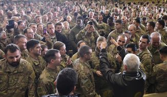 U.S. Vice President Mike Pence sgreets troops in a hangar at Bagram Air Base in Afghanistan on Thursday, Dec. 21, 2017. Mandel Ngan/Pool via AP) **FILE**
