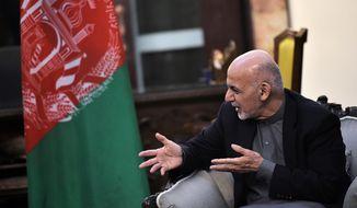 Afghan President Ashraf Ghani talks with U.S. Vice President Mike Pence at the President Palace in Kabul, Afghanistan, on Thursday, Dec. 21, 2017. (Mandel Ngan/Pool via AP)