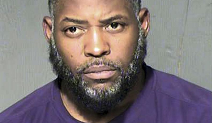 FILE - This undated file photo provided by the Maricopa County Sheriff's Department shows Abdul Malik Abdul Kareem. The lawyer for the Phoenix man convicted of helping two Islamic State followers in a 2015 attack on a Prophet Muhammad cartoon contest in Texas, argued in an appeal Wednesday, Dec. 20, 2017, that prosecutors withheld evidence during his trial, including the fact that an undercover FBI agent was at the scene just before the two attackers opened fire outside the anti-Islam event.  (Maricopa County Sheriff's Department via AP, File)
