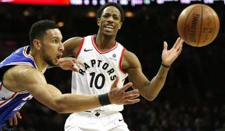 Philadelphia 76ers guard Ben Simmons (25) gets the ball away from Toronto Raptors guard DeMar DeRozan (10) during the first half on an NBA basketball game, Thursday, Dec. 21, 2017, in Philadelphia. (AP Photo/Laurence Kesterson)