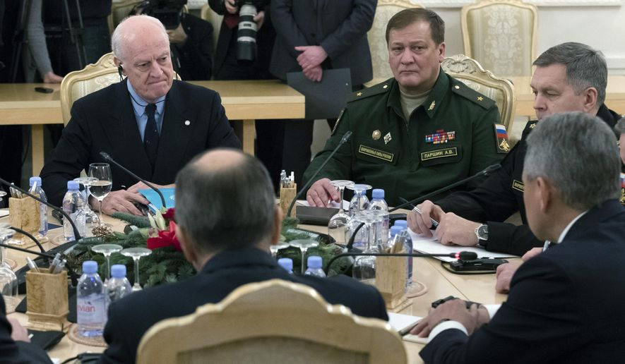 UN Special Envoy for Syria Staffan de Mistura, left, listens to Russian Defence Minister Sergei Shoigu, bottom right, and Russian Foreign Minister Sergey Lavrov, bottom center, during their Syria-focused talks in Moscow, Russia, Thursday, Dec. 21, 2017. (AP Photo/Ivan Sekretarev)
