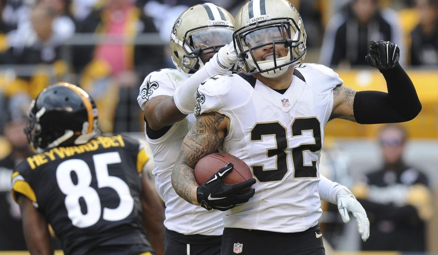 FILE - In this Sunday, Nov. 30, 2014  file photo, New Orleans Saints strong safety Kenny Vaccaro (32) celebrates making an interception of a pass to Pittsburgh Steelers wide receiver Darrius Heyward-Bey (85) in the second quarter of the NFL game in Pittsburgh. The New Orleans Saints have placed Kenny Vaccaro on injured reserve, ending the starting safety's season. Vaccaro, whose status appeared on the NFL's official transactions report on Thursday, Dec. 21, 2017, has been in and out of the lineup with groin injuries since a Week 9 victory over Tampa Bay on Nov. 5. (AP Photo/Don Wright, File)