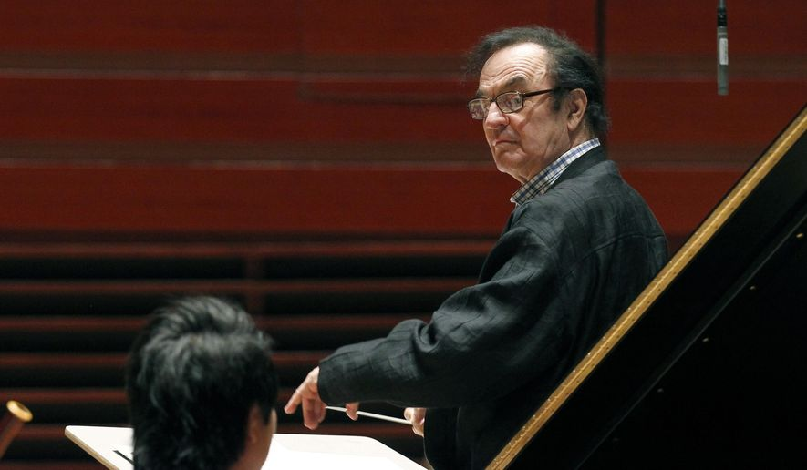 In this Oct. 19, 2011, file photo, world-renowned conductor Charles Dutoit, right, performs with the Philadelphia Orchestra during a rehearsal in Philadelphia. Four women have accused Dutoit of sexual misconduct that allegedly occurred on the sidelines of rehearsals or performances with some of America's great orchestras. The 81-year-old is the artistic director and principal conductor at London's Royal Philharmonic Orchestra. (AP Photo/Alex Brandon, File)