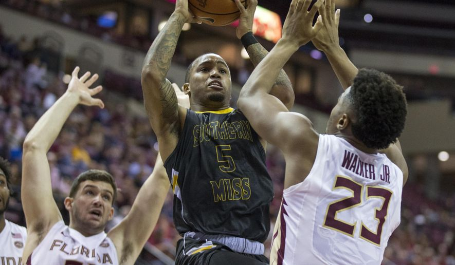 Southern Miss guard Tyree Griffin (5) takes a jump shot between Florida State forward Wyatt Wilkes (31) and guard M.J. Walker (23) in the first half of an NCAA college basketball game in Tallahassee, Fla., Thursday, Dec. 21, 2017. (AP Photo/Mark Wallheiser)