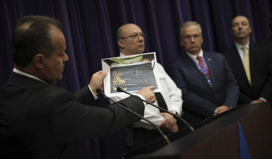 Anthony Riccio, chief of the Chicago Police Department's organized crime unit, describes an investigation into sales of drugs and guns in an invitation-only group on Facebook during a news conference at Chicago Police Department headquarters Thursday, Dec. 21 2017, in Chicago. (E. Jason Wambsgans/Chicago Tribune via AP)