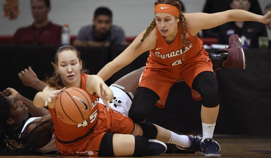 Syracuse forward Digna Strautmane (45) and guard Tiana Mangakahia chase the ball next to a Mississippi State player during the first half of an NCAA college basketball game Thursday, Dec. 21, 2017, in Las Vegas. (AP Photo/David Becker)