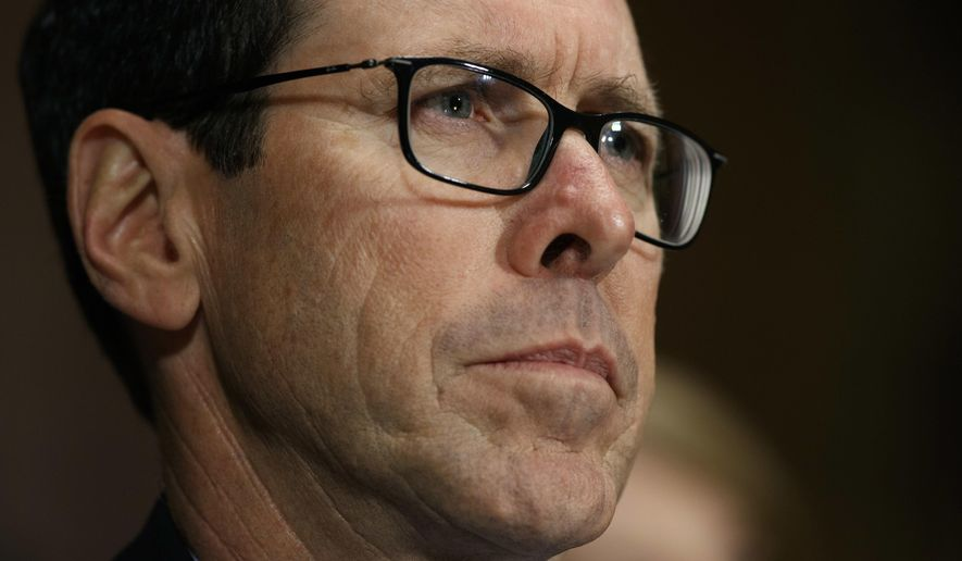 FILE - In this Dec. 7, 2016 file photo, AT&T Chairman and CEO Randall Stephenson listens on Capitol Hill in Washington, while testifying before a Senate Judiciary subcommittee hearing on the proposed merger between AT&T and Time Warner. After an exchange between AT&T's CEO and a union representing its workers, the company says it took steps to pay workers a $1,000 bonus in response to President Donald Trump's tax cuts. The Communications Workers of America had pushed AT&T last month to guarantee workers would receive the $4,000 raise that White House economists said would be the result of the corporate tax cuts.  (AP Photo/Evan Vucci, File)