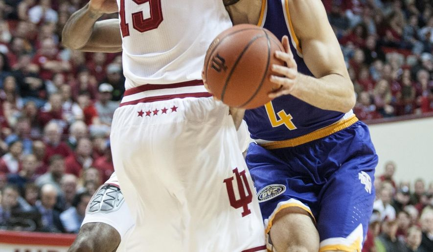 Tennessee Tech guard Aleska Jugovic (4) runs into Indiana guard Zach McRoberts (15) during the first half of an NCAA college basketball game in Bloomington, Ind., Thursday, Dec. 21, 2017. (Alex McIntyre/The Herald-Times via AP)