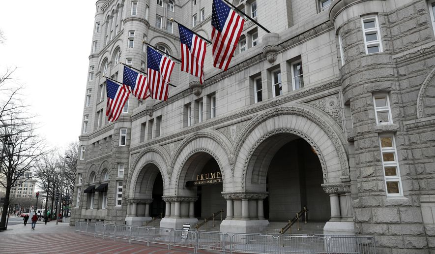 FILE- In this Dec. 21, 2016 file photo, the Trump International Hotel in Washington is shown. On Thursday, Dec. 21, 2017, a New York judge has rejected a lawsuit by restaurant workers, a hotel event booker and a watchdog group who say President Donald Trump has business conflicts that violate the Constitution. The lawsuit was rejected by federal Judge George Daniels, who says the plaintiffs lacked standing to sue. (AP Photo/Alex Brandon, File)
