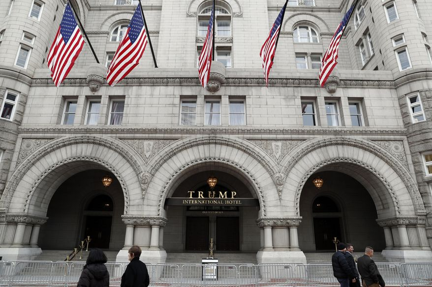 The Trump International Hotel in Washington is shown. On Thursday, Dec. 21, 2017, a New York judge has rejected a lawsuit by restaurant workers, a hotel event booker and a watchdog group who say President Donald Trump has business conflicts that violate the Constitution. The lawsuit was rejected by federal Judge George Daniels, who says the plaintiffs lacked standing to sue. (AP Photo/Alex Brandon, File)