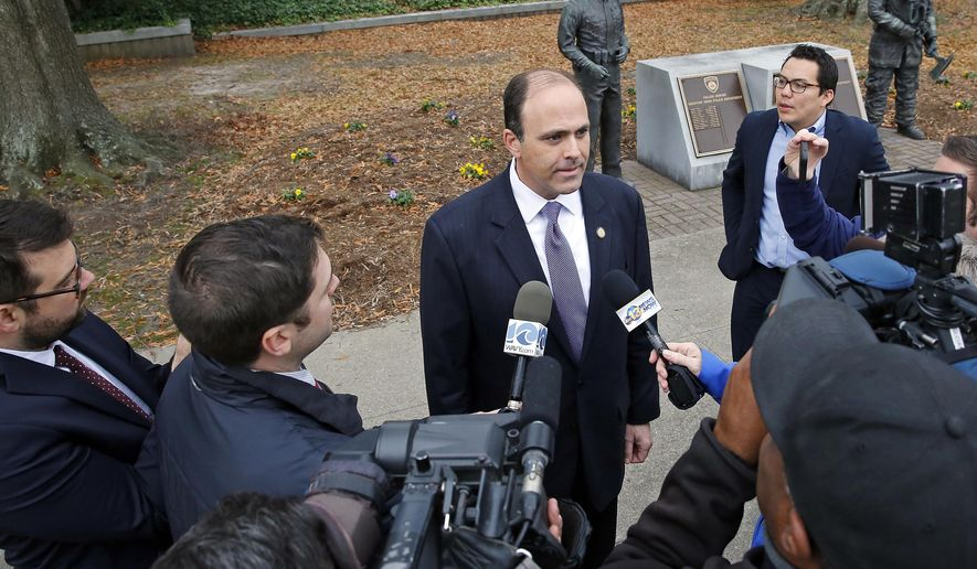 Del. David Yancey talks with reporters outside the Newport News, Va., Courthouse, Wednesday, Dec. 20, 2017. A three-judge panel certified the 94th District in Newport News as tied on Wednesday, a day after a dramatic recount appeared to give Democrat Shelly Simonds a victory over Del. David Yancey by a single vote. (Jonathon Gruenke/The Daily Press via AP)