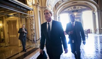 Special Counsel Robert Mueller departs the Capitol after a closed-door meeting with members of the Senate Judiciary Committee about Russian meddling in the election and possible connection to the Trump campaign, in Washington. (AP Photo/J. Scott Applewhite)