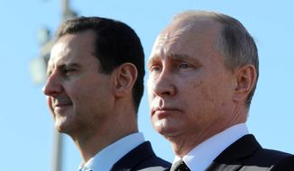 Russian President Vladimir Putin, right, and Syrian President Bashar Assad watch the troops marching at the Hemeimeem air base in Syria in this Monday, Dec. 11, 2017, file photo. Nearly seven years into the conflict, the war in Syria seems on one level to be winding down, largely because of Russian-backed government victories and local cease-fires aimed at freezing the lines of conflict. (Mikhail Klimentyev, Sputnik, Kremlin Pool Photo via AP, File)